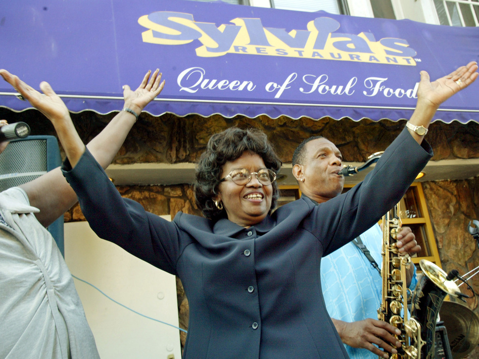 Sylvia Woods moves to the music outside her restaurant in Harlem neighborhood of New York, during the restaurant's 40th anniversary celebration in 2002.
