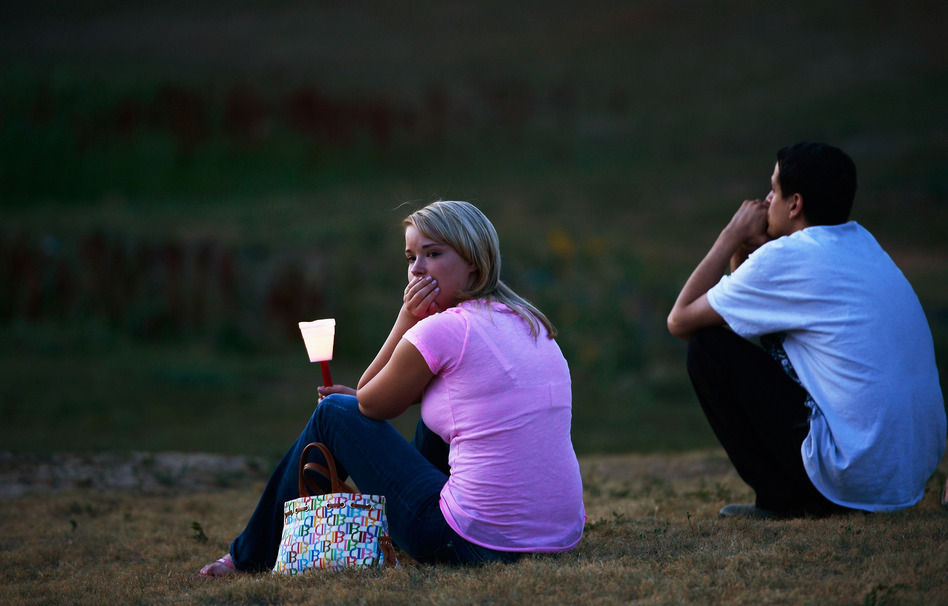 Mourners also held a candelight vigil in Devner, Colo., Friday. (Getty Images)