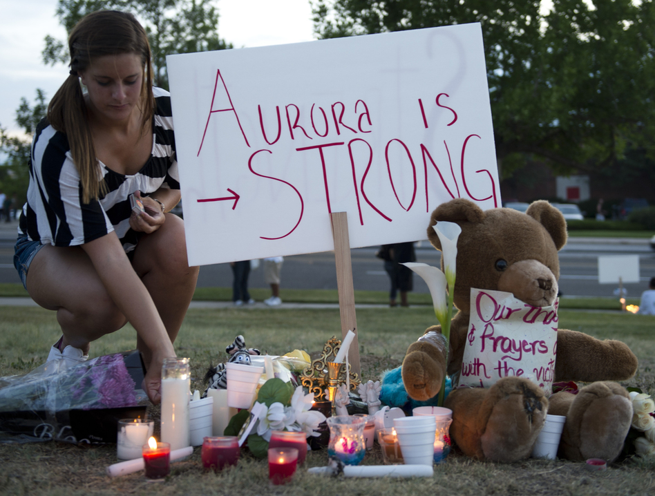 Mourners held a vigil in Aurora Friday, though an official one is scheduled for Sunday evening. (AFP/Getty Images)