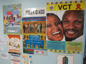 Anti-AIDS posters hang in the Eshowe public health clinic in South Africa's Kwazulu-Natal prov