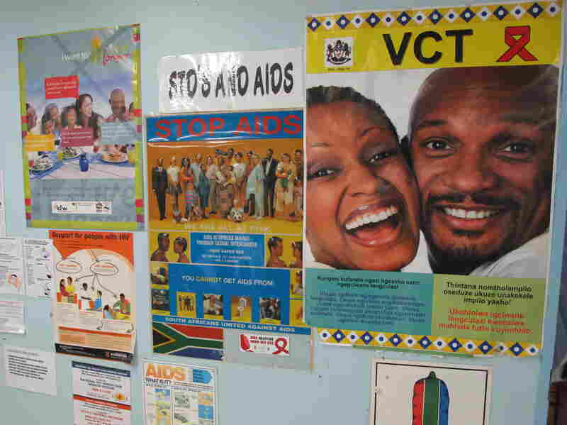 Anti-AIDS posters hang in the Eshowe public health clinic in South Africa's Kwazulu-Natal province. Clinicians there are hoping to slow the spread of HIV by getting more people treatment.
