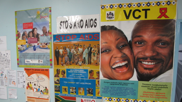 Anti-AIDS posters hang in the Eshowe public health clinic in South Africa's Kwazulu-Natal province. Clinicians there are hoping to slow the spread of HIV by getting more people treatment. (NPR)