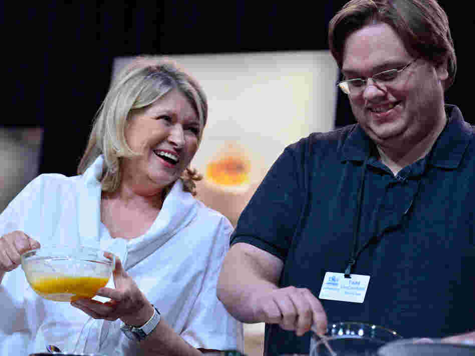Martha Stewart and Todd VanDerWerff work on omelets during her cooking demonstration.