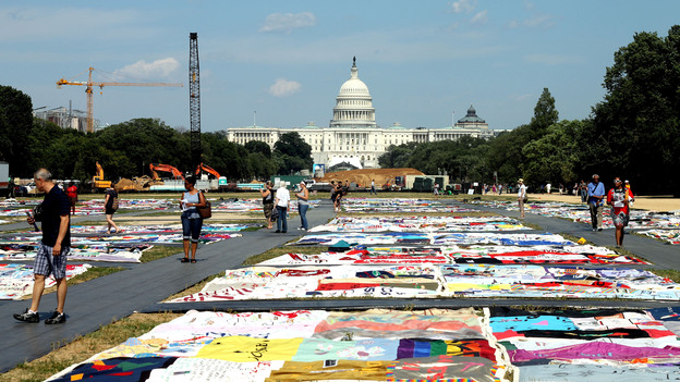 Visitors view the AIDS Memorial Quilt at the National Mall in Washington, D.C., where the International AIDS Conference is being held this week. (NPR)