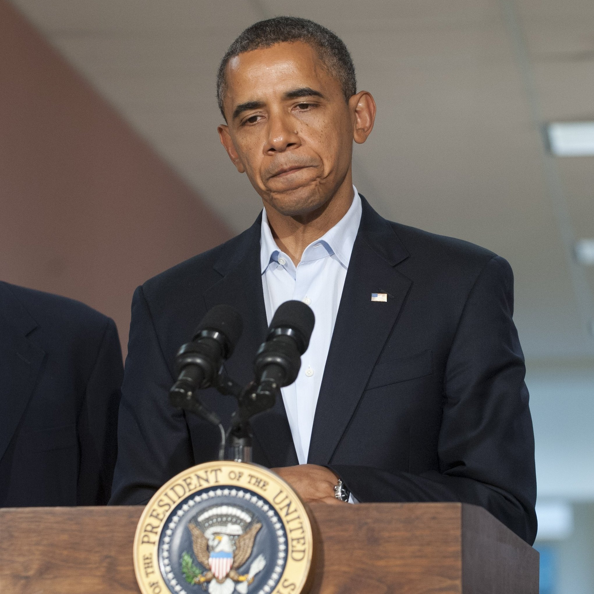President Obama speaks alongside Colorado Sen. Mark Udall and Colorado Gov. John Hickenlooper (right) at the University of Colorado Hospital in Aurora on Sunday, following a visit with victims and family members.