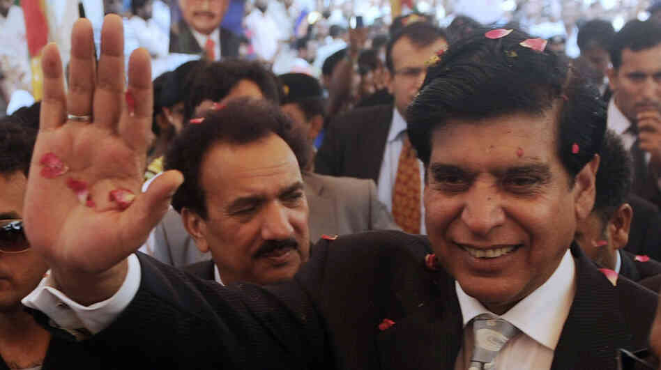 Pakistani Prime Minister Raja Pervez Ashraf is greeted after his election in June. Just weeks later, many Pakistanis expect the nation's Supreme Court may soon attempt to force Ashraf from his position, as it did his predecessor.