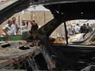 In Baghdad's Sadr City district, the view through a vehicle that was destroyed in one of today's attacks.