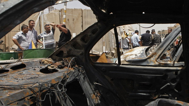In Baghdad's Sadr City district, the view through a vehicle that was destroyed in one of today's attacks. (AP)