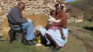 A Doctors Without Borders counselor tests a South African woman for HIV.