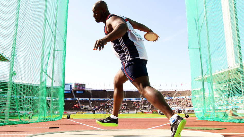 Britain's Abdul Buhari competes in the discus at the European Athletics Championships last month. With the Olympics coinciding with Ramadan, Buhari and many other Muslim athletes are postponing their fasting until after their events. (Getty Images)