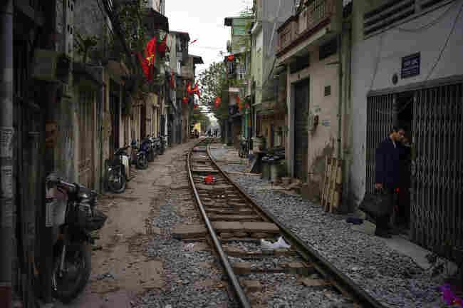 A neighborhood built along railroad tracks is seen in Hanoi, Vietnam, February 2010.