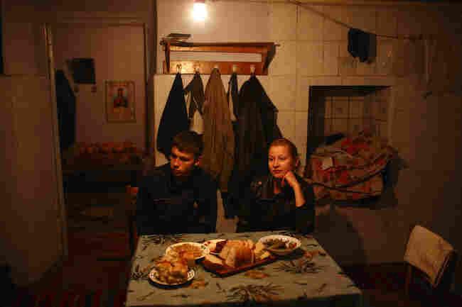 Dinner in a farmhouse in Chobruchi, Moldova, April 2009.