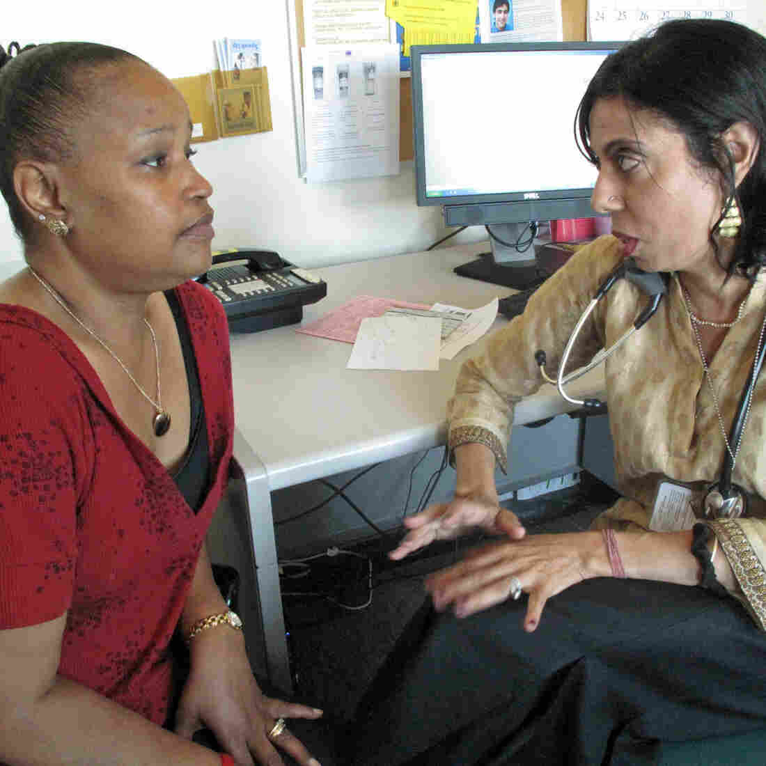 """HIV patient Darnell Hollie, 47, talks to her doctor Monica Gandhi (right) at San Francisco General Hospital. Her path from drug addict to model patient was """"a lot of work, but if you want it, it's there for you,"""" Hollie says."""