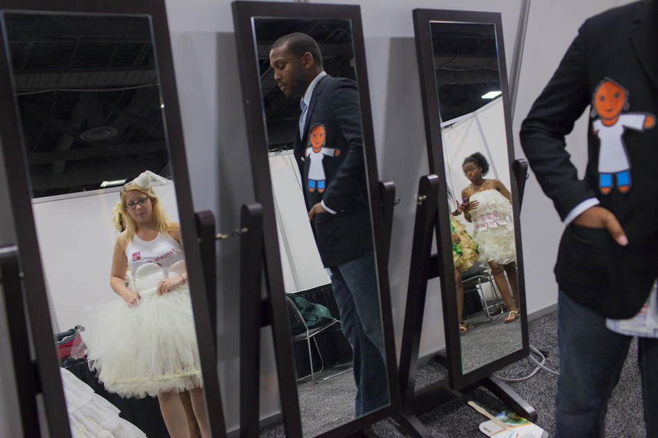 The organizers of the show aimed to reduce the taboo of talking about female condoms and the role they can play in stopping HIV infections. Kristina DeRose (left) from Philadelphia, Cramonte Hairston (center) and Iesha Gadsden of Washington, prepare backstage. (NPR)
