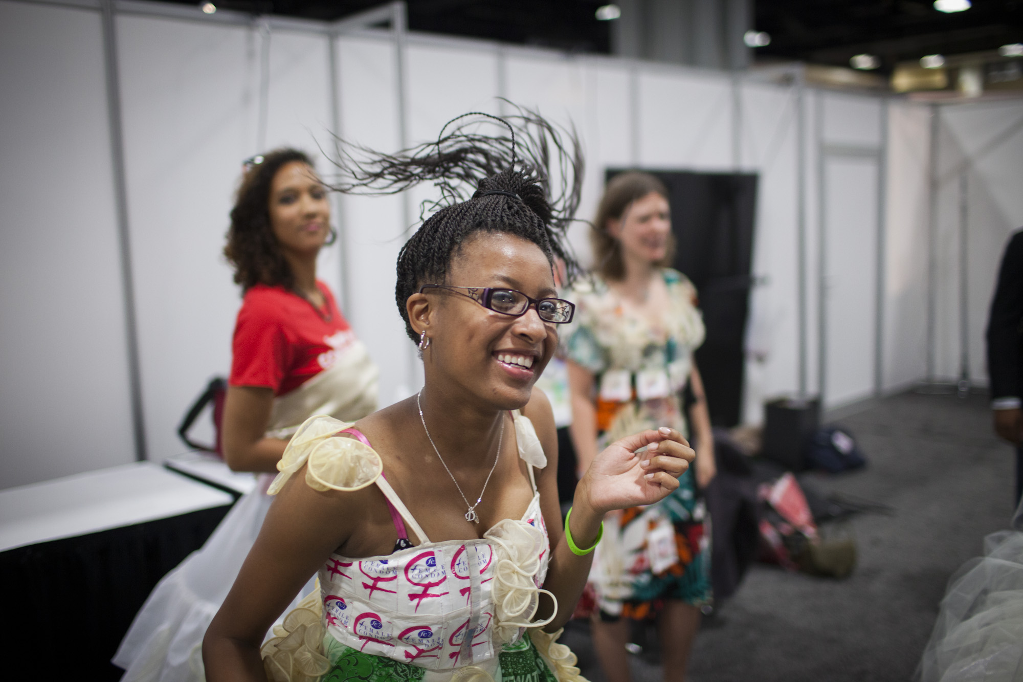 A fashion show at the 19th International AIDS Conference aimed to raise awareness of female condoms -- the only woman-initiated means of contraception that can prevent HIV infection. Diamond Gillespie has a laugh before going on stage. The top of her dress is decorated with female condom wrappers.