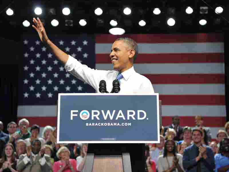 President Barack Obama waves as he arrives on stage to speak at a campaign event at Prime Osborn Convention Center on July 19 in Jacksonville, Fla.