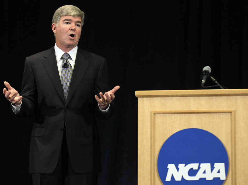 NCAA President Mark Emmert answers questions about the sanctions against Penn State's football team during a news conference in Indianapolis, Monday, J