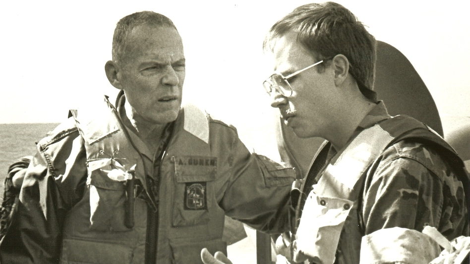 David Crist's father, George (left), discusses operations against Iranian attack boats with Navy Lt. Paul Hillenbrand. George Crist, a Marine Corps general, was commander of CENTCOM from 1985-1988. (Courtesy of David Crist)