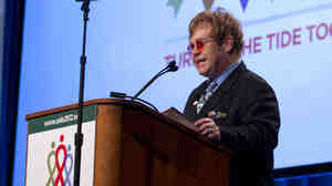 Sir Elton John speaks Monday at the 19th International AIDS Conference in Washington.