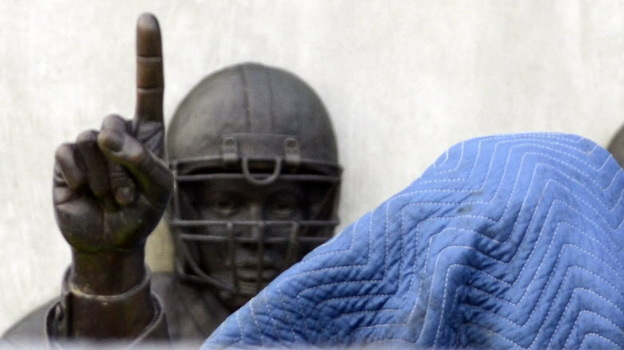 Before its removal from outside the school's football stadium on Sunday, a statue of former football coach Joe Paterno was covered. An independent report concluded he was among top university officials who failed to act when they learned that Jerry Sandusky might be sexually abusing young boys. (AP)