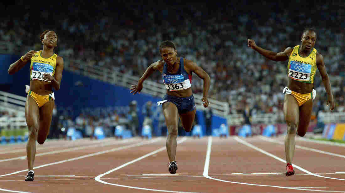 Sherone Simpson of Jamaica, Lauryn Williams of the U.S. and Veronica Campbell of Jamaica compete in the women's 100 meter final at the Athens 2004 Summer Olympic Games, the race in which Williams won her silver medal.