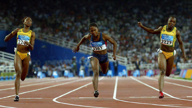 Sherone Simpson of Jamaica, Lauryn Williams of the U.S. and Veronica Campbell of Jamaica compete in the women's 100 meter final at the Athens 2004 Summer Olympic Games, the race in which Williams won her silver medal. (Getty Images)