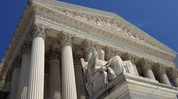 When the U.S. Supreme Court made a Medicaid expansion optional under the Affordable Care Act, the decision lowered the estimated cost of the law. (Getty Images)