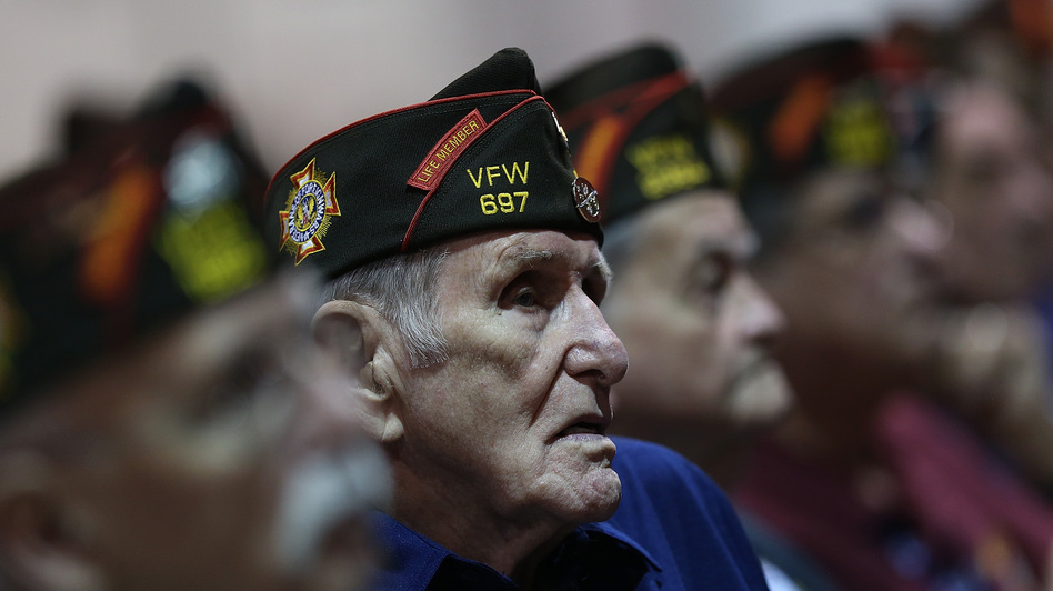 Members of the Veterans of Foreign Wars look on Monday as President Obama speaks during the group's national convention in Reno, Nev. Republican Mitt Romney was scheduled to speak to the group on Tuesday.