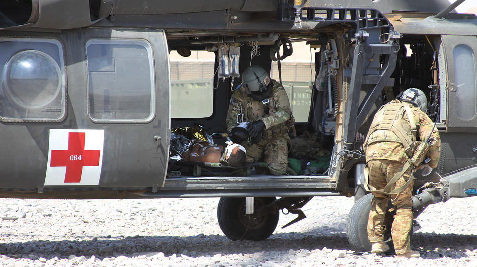 A NATO/U.S. medevac helicopter transports an Afghan civilian wounded by an IED near Camp Ricketts, a small NATO base in Muqur District, Badghis Province. (NPR)