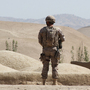 A Spanish NATO soldier on patrol in Afghanistan. Insurgents in the country have been busier this summer than last, and more often than not, civilians are paying the price.