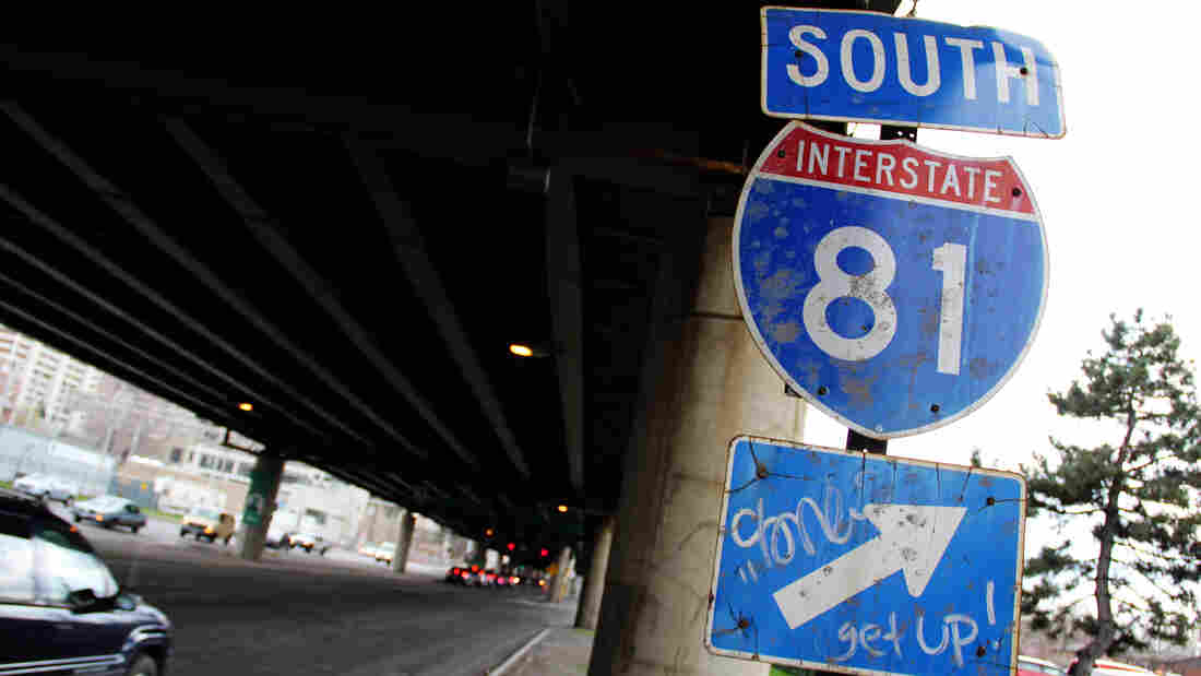 A sign for Interstate 81 sits under an overpass in Syracuse, N.Y. City officials and residents are debating what to do about an aging stretch of the highway that cuts through the city.