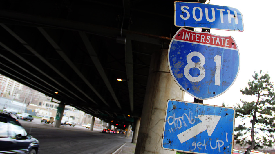 A sign for Interstate 81 sits under an overpass in Syracuse, N.Y. City officials and residents are debating what to do about an aging stretch of the highway that cuts through the city. (Zack Seward for NPR)
