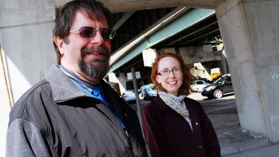 Bill Egloff, I-81 project manager for the New York State Department of Transportation, and Meghan Vitale of the Syracuse Metropolitan Transportation Council stand underneath the I-81 viaduct in Syracuse, N.Y. (Zack Seward for NPR)