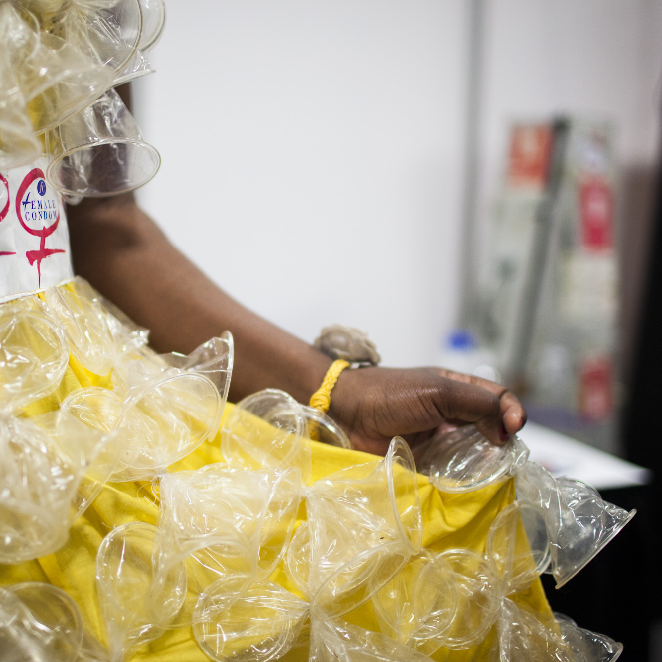 "At the International AIDS conference, a female condom fashion show raised awareness about the rising need for more female condoms. Olwin Manyanye of Zimbabwe shows off one of the dresses decorated with a second-generation female condom, called ""FC2."""