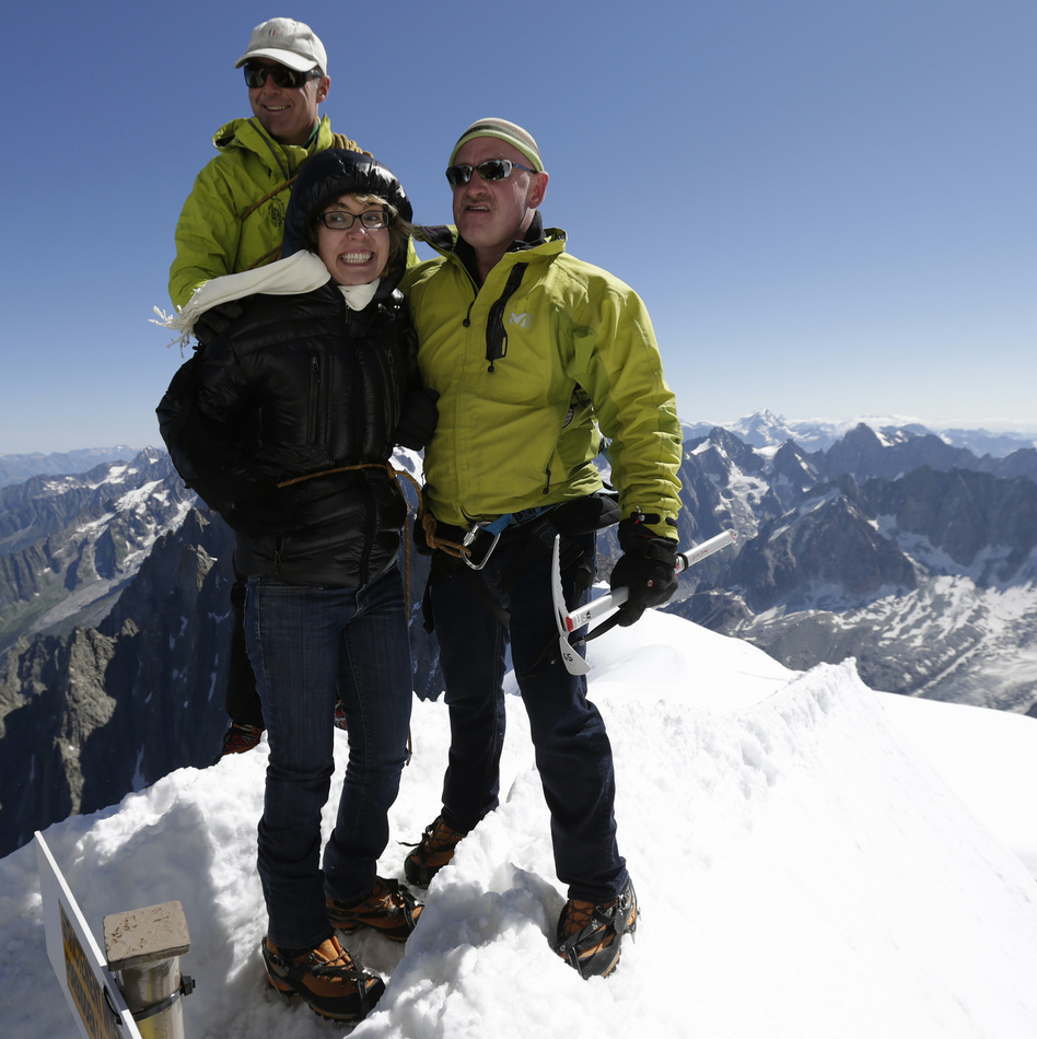Former Rep. Gabrielle Giffords (center) and her husband Mark Kelly (right), at the peak of Aiguille du Midi in the French Alps on Monday. Behind them is mountain guide Vincent Lameyre.