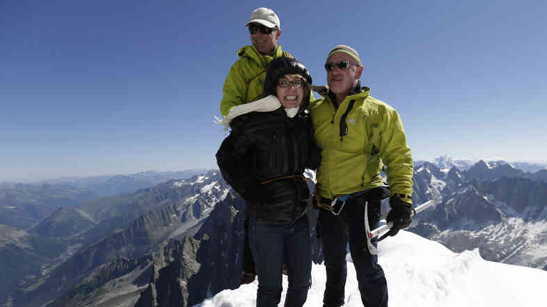 Former Rep. Gabrielle Giffords (center) and her husband Mark Kelly (right), at the peak of Aiguille du Midi in the French Alps on Monday. Behind them is mounta
