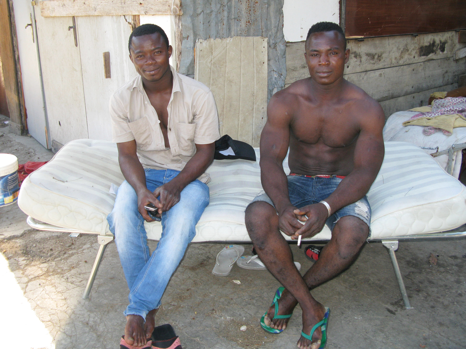 African migrants fired from Italian factories in the north have joined the swelling ranks of people searching for agriculture work in the south. Originally from Burkina Faso, Karim Suruku (right) is a migrant worker in Calabria in southern Italy. At left is Amidou Denamidou.