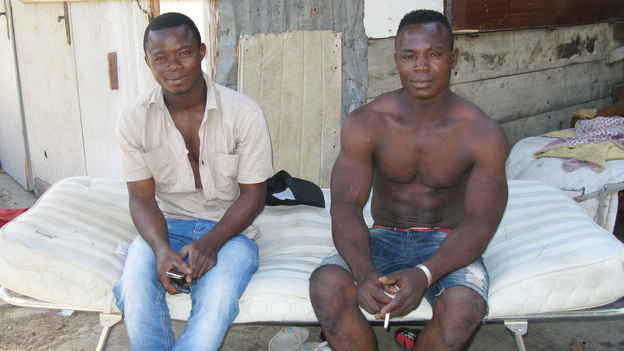 African migrants fired from Italian factories in the north have joined the swelling ranks of people searching for agriculture work in the south. Originally from Burkina Faso, Karim Suruku (right) is a migrant worker in Calabria in southern Italy. At left is Amidou Denamidou. (NPR)