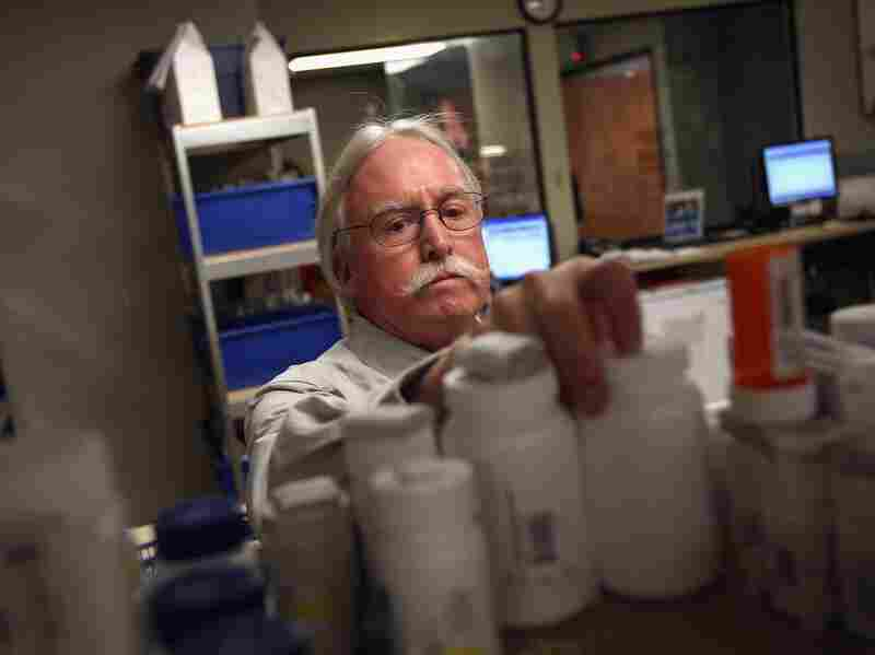 Pharmacy director Hank Wedemeyer prepares to fill a prescription at a community health center on March 27, in Aurora, Colorado. The center, the Metro Community Provider Network, has received some 6,000 more Medicaid eligable patients since the healthcare reform law was passed in 2010.