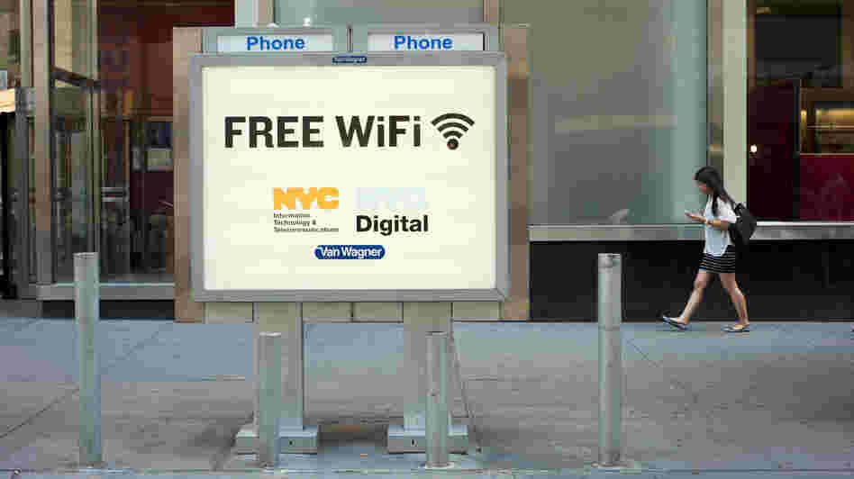 A phone booth serves as a free Wi-Fi hot spot in New York City's Columbus Circle.