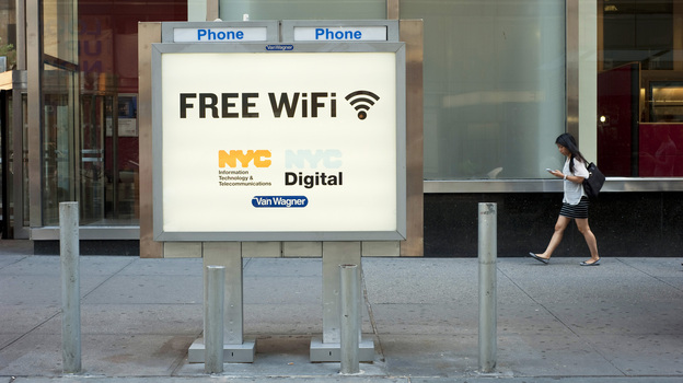 A phone booth serves as a free Wi-Fi hot spot in New York City's Columbus Circle. ( )