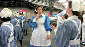 March of the Nurses: A group of performers waits to rehearse their role in the Olympics Opening Ceremony Friday.