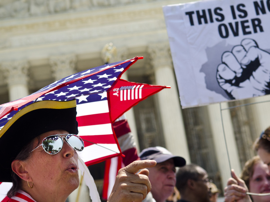 Susan Clark argues with  another protester about the Affordable Care Act outside the U.S. Supreme Court. (Getty Images)