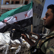 A Free Syrian Army solider mans a checkpoint in the northern town of Ariha, on the outskirts of Idlib, Syria, last month. In rural areas held by rebels, new institutions are cropping up to fill the void left by the receding Syrian state.