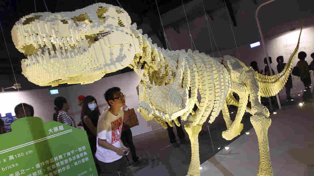 """A visitor looks at artist Nathan Sawaya's Lego sculpture """"T-Rax"""" at """"The Art of the Brick"""" exhibition in Taiwan earlier this month."""