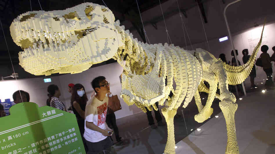 "A visitor looks at artist Nathan Sawaya's Lego sculpture ""T-Rax"" at ""The Art of the Brick"" exhibition in Taiwan earlier this month."