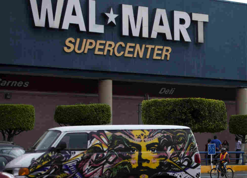 A van covered by a mural sits parked outside a Walt-Mart Super Center in Mexico City.