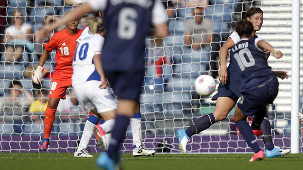 Carli Lloyd scores the U.S. team's winning goal, in a comeback win over France. The Americans are bidding for their third straight Olympic gold medal. (AFP/Getty Images)