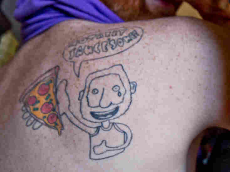 Dwyer branded himself with a tattoo of himself holding a slice.