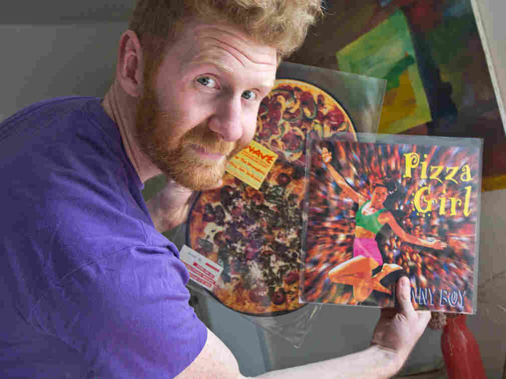Brian Dwyer owns the world's largest collection of pizza-related items. He plans to display some of his memorabilia, including pizza-themed music records, in a new museum-restaurant in Philadelphia.
